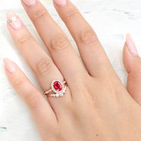 vintage inspired oval ruby ring and curved 7 stone diamond wedding band in rose gold bridal set by la more design jewelry