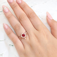 vintage inspired ruby ring and curved leaf diamond wedding band in rose gold bridal set by la more design jewelry
