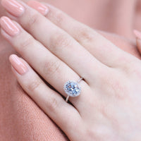white gold oval aquamarine halo diamond engagement ring by la more design