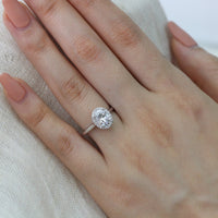 white gold oval moissanite engagement ring halo diamond band by la more design
