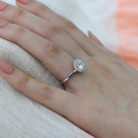 white gold round moissanite engagement ring halo diamond band by la more design