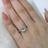 yellow gold aquamarine ring halo diamond pear engagement ring by la more design