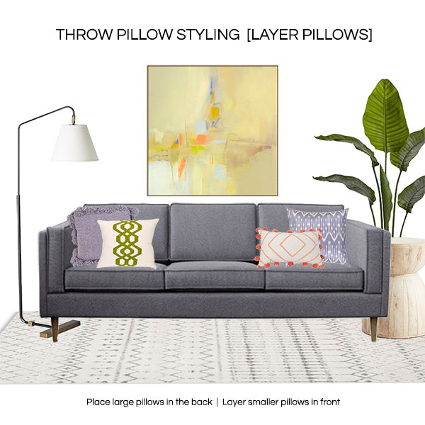How to style throw pillows 2019 - layer different sized pillows