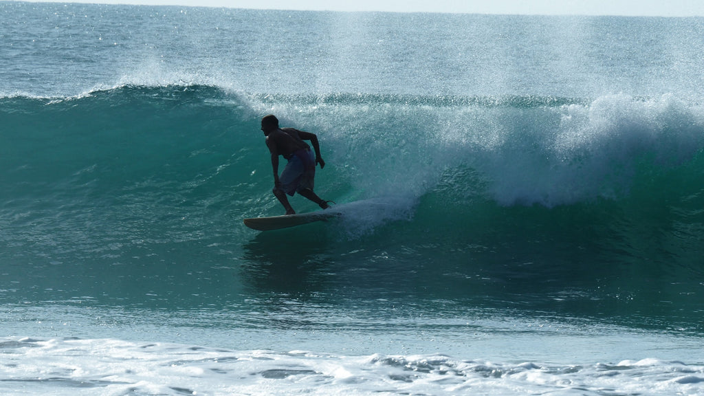 Jaya surfing on Sri Lankan wave during surf trip