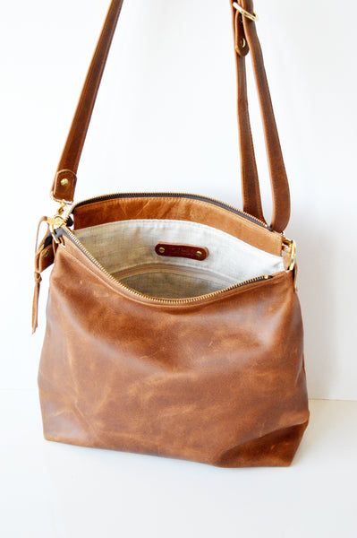 Leather hobo bag lined in natural oatmeal linen