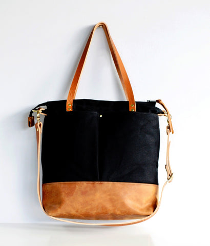 Black and tan leather diaper bag 1_edited.jpg