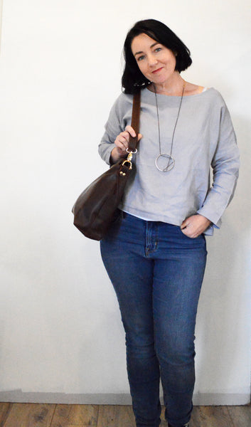 Dark Brown leather hobo bag worn on shoulder