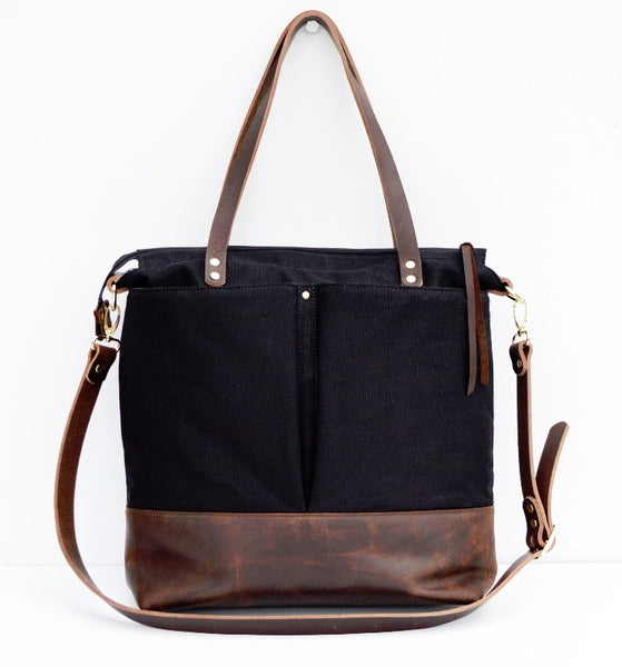 Black canvas and dark brown leather diaper tote bag