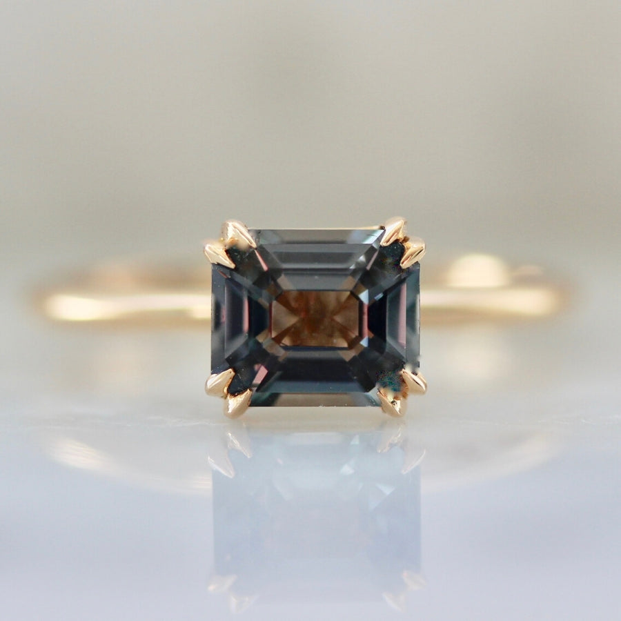 Stella Berry Blue Emerald Cut Spinel in Peach Gold