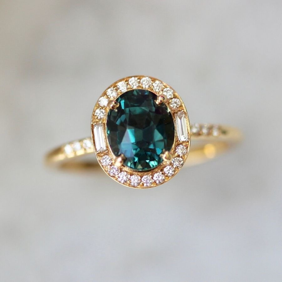 Elsie Oval Sapphire and Diamond Halo Ring in Yellow Gold