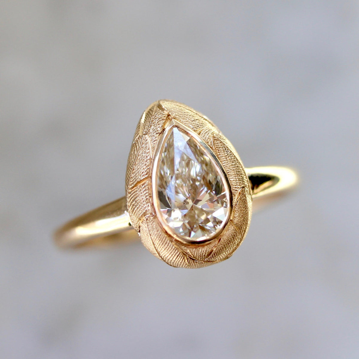 Flickering Fire Champagne Pear Cut Diamond