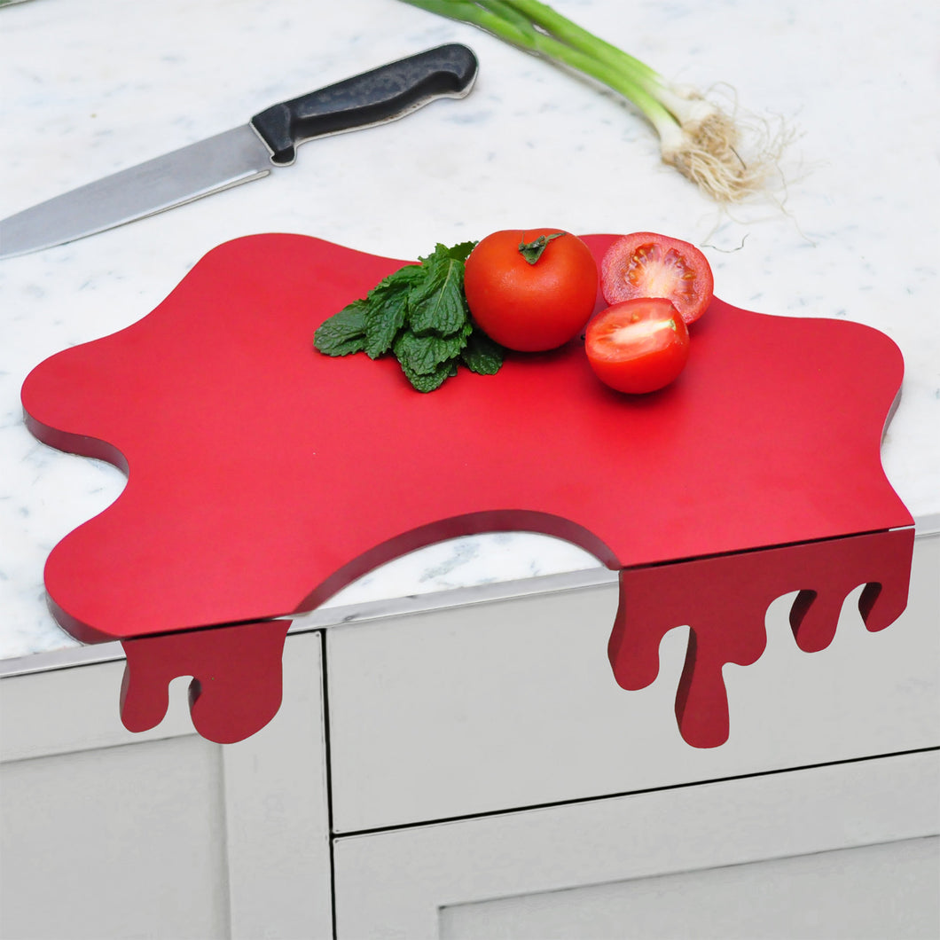 Tomato splash chopping board