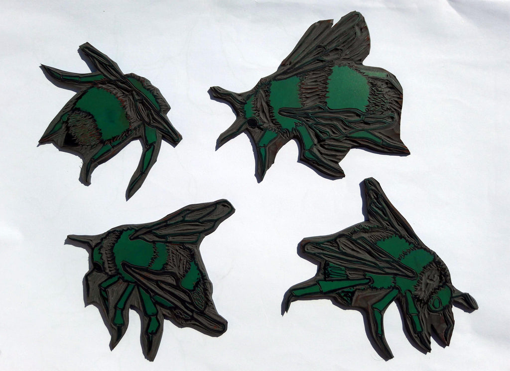 Four bee linocuts