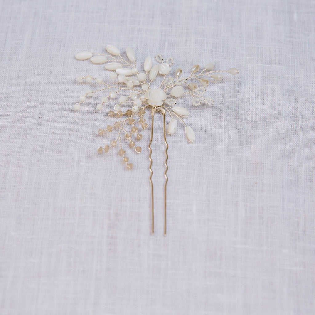 Bridal Hair Pin featuring pearls and crystals in a floral design