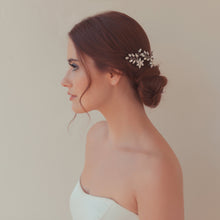 Bride wearing crystal hair pins