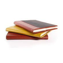 Notebooks made from recycled firehose