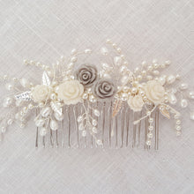 Bridal Hair Comb in silver featuring pearls and crystals in a floral design