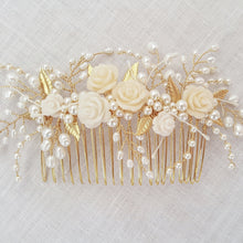 Bridal Hair Comb in gold featuring pearls and crystals in a floral design