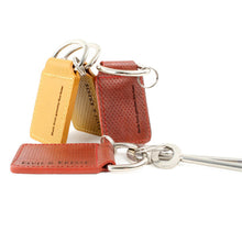 Collection of key rings made from reclaimed fire hose
