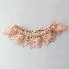 Blush pink garter for your wedding day with blue bow detail