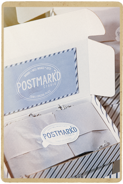 Open Postmark'd Studio Box with Stacked Boxes in Background