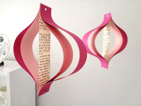 Valentines Day paper decorations, recycled romance novels, retro geometric curves, pink white