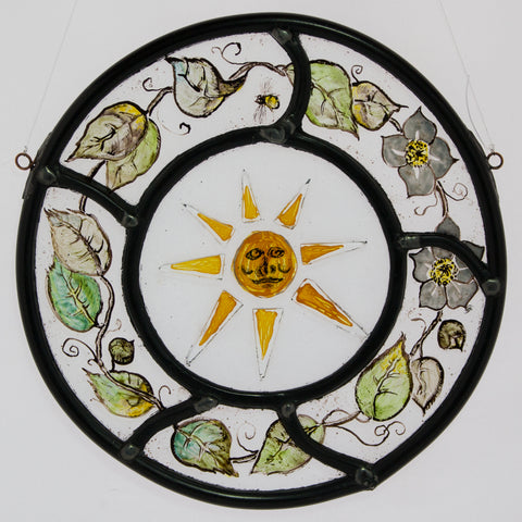 Stained and painted glass round sun and leaf wreath