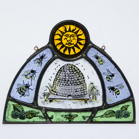 Stained and painted glass bees and beehive