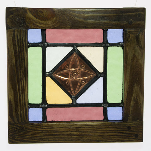 Stained glass in a wooden frame with embossed copper centre