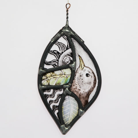 Stained and painted glass leaf with bird's head