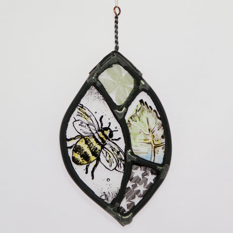 Stained and painted glass leaf with bee