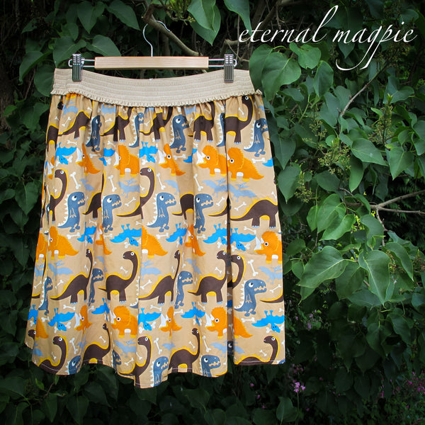 eternal magpie up cycled dinosaur print skirt with pockets and elastic waist