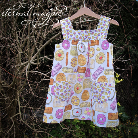 In stock: Child's upcycled white Favourite Biscuits print dress, age 3 years