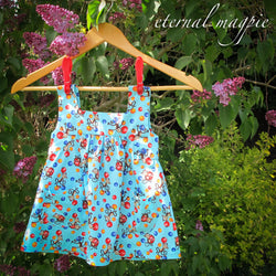 In stock: Child's blue monkey print dress, age 18 months