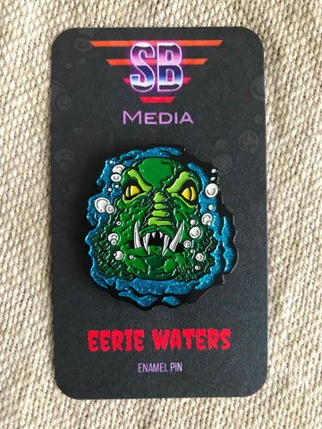 scary basement media, enamel pin, eerie waters, vile consumption