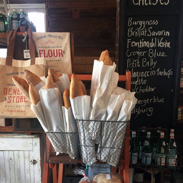 spruce home goods offers a variety of bread, cheese, and wine