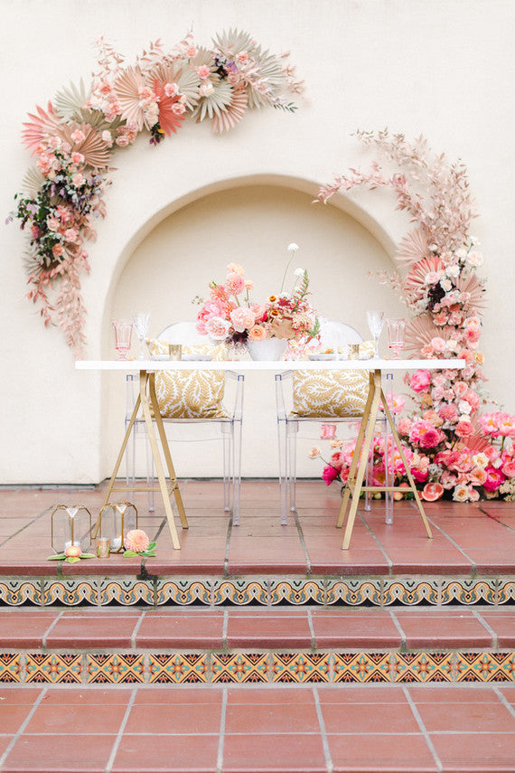 floral backdrop and archway for wedding