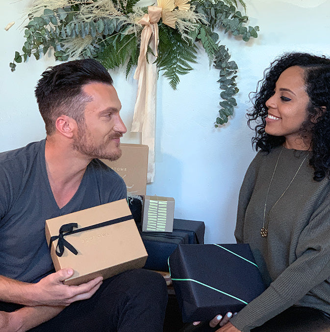 Holiday gift exchange between man and woman
