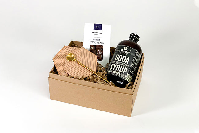 ginger drink gift box with leather coasters and bourbon pecans