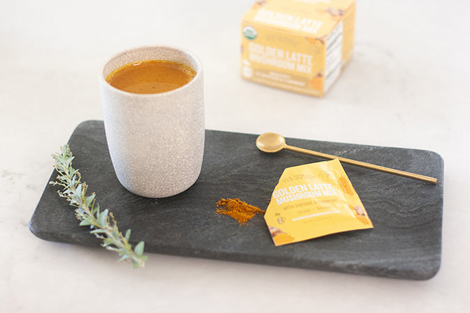 mushroom turmeric tea on black marble tray