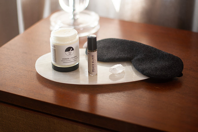 peace elixir body butter and eye mask on modern table