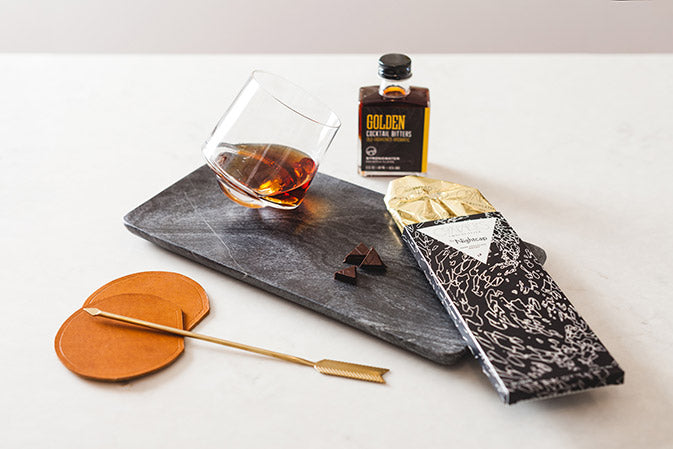 bar and cocktail set with dark whiskey chocolate