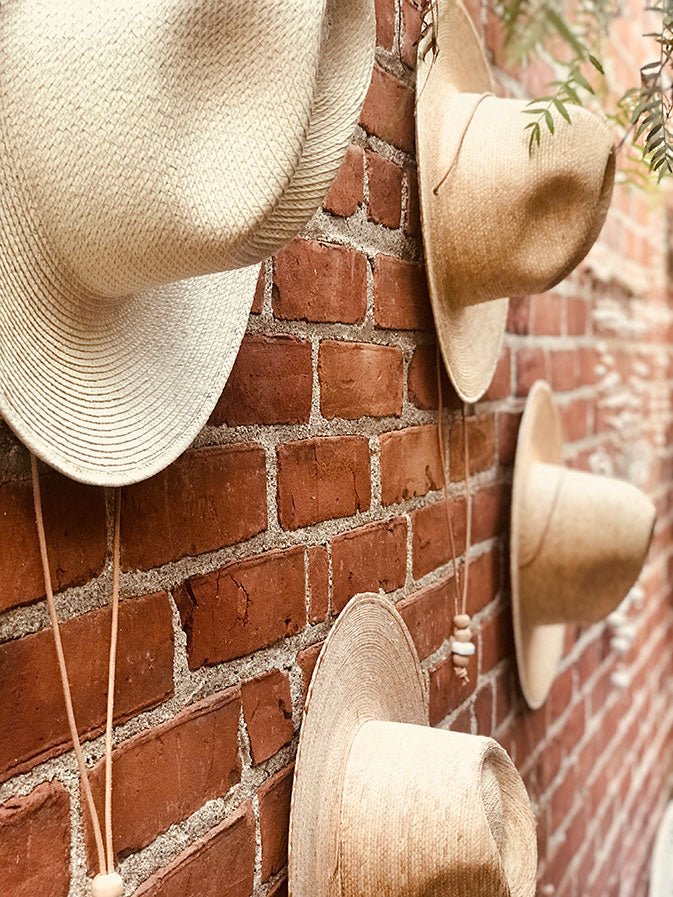 hats on a brick wall