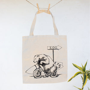 Bear with Surfboard Riding on Bike Canvas Tote