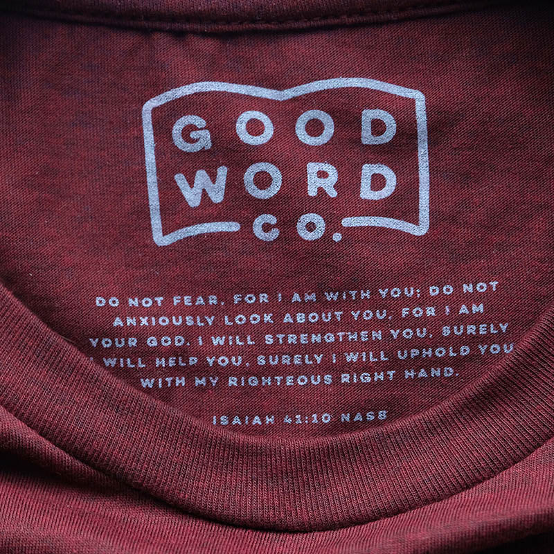 "Be Brave Good Word Co. shirt inspired by the Bible verse Isaiah 41:10. Image shows the Bible verse ""Do not fear, for I am with you; Do not anxiously look about you, for I am your God. I will strengthen you, surely I will help you, Surely I will uphold you with My righteous right hand."""