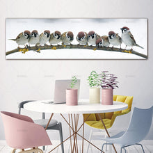 Birds Flock on a Branch Canvas Print