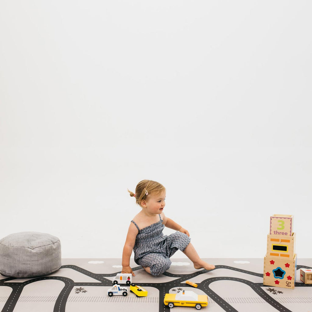 The Cali Rug in Rose Pink • Two-Sided, Memory Foam Play Mat with Interactive Play Map on the Back