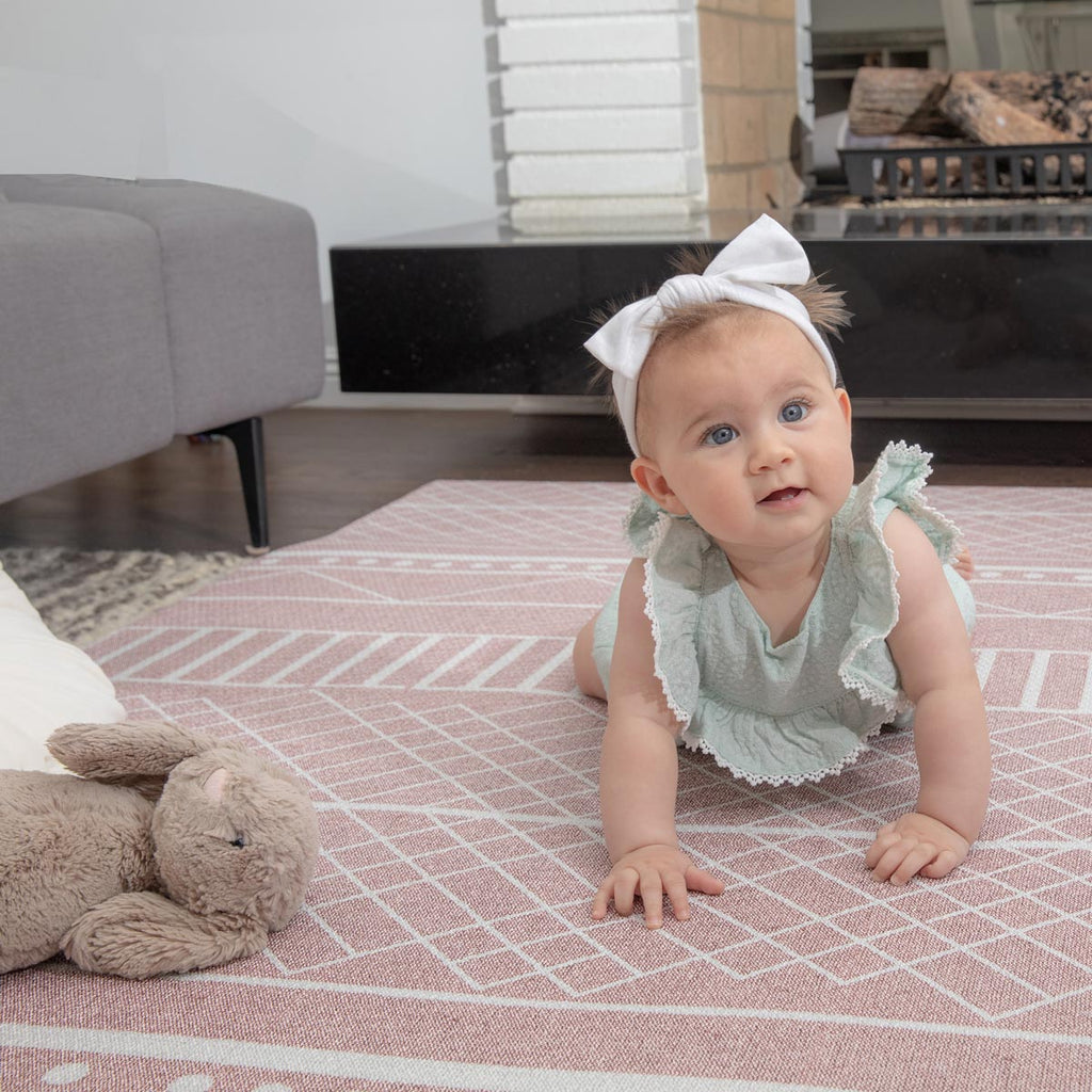 The Cali Rug in Rose Pink • Two-Sided, Memory Foam Play Mat with Modern, Boho-Inspired Designer Rug Pattern
