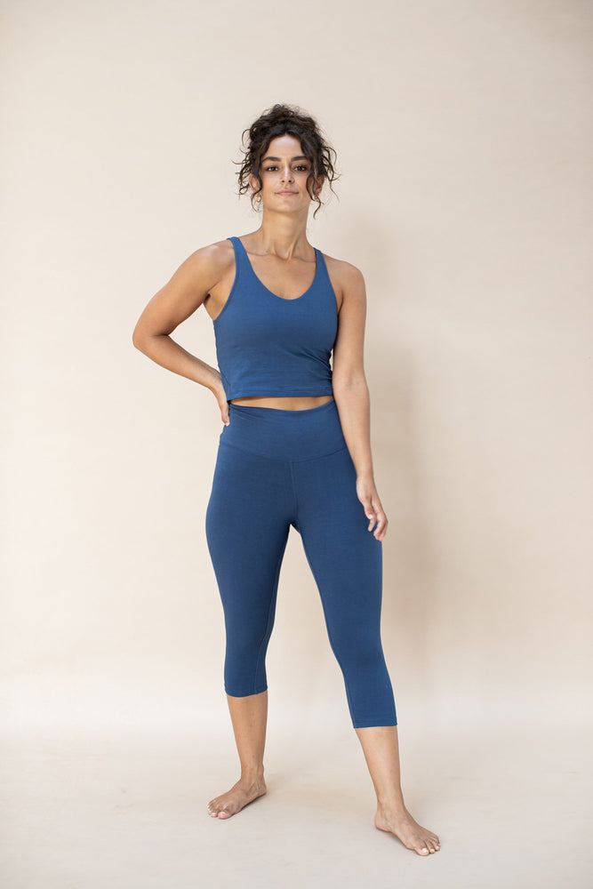 Woman standing, wearing Ananda capri colour French Blue