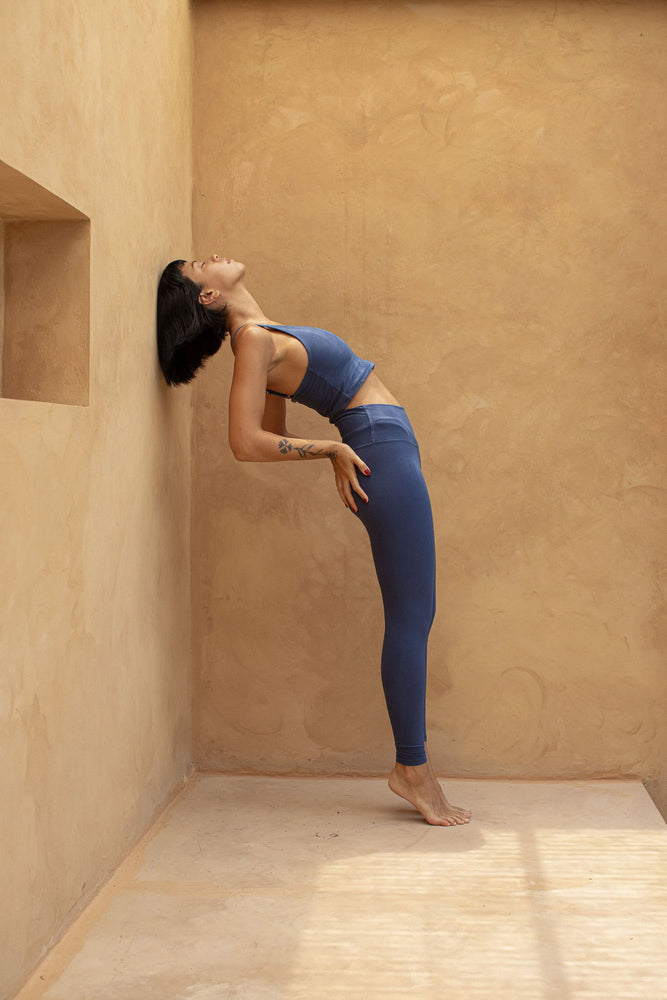 Woman doing yoga pose, wearing Ananda Legging colour French blue